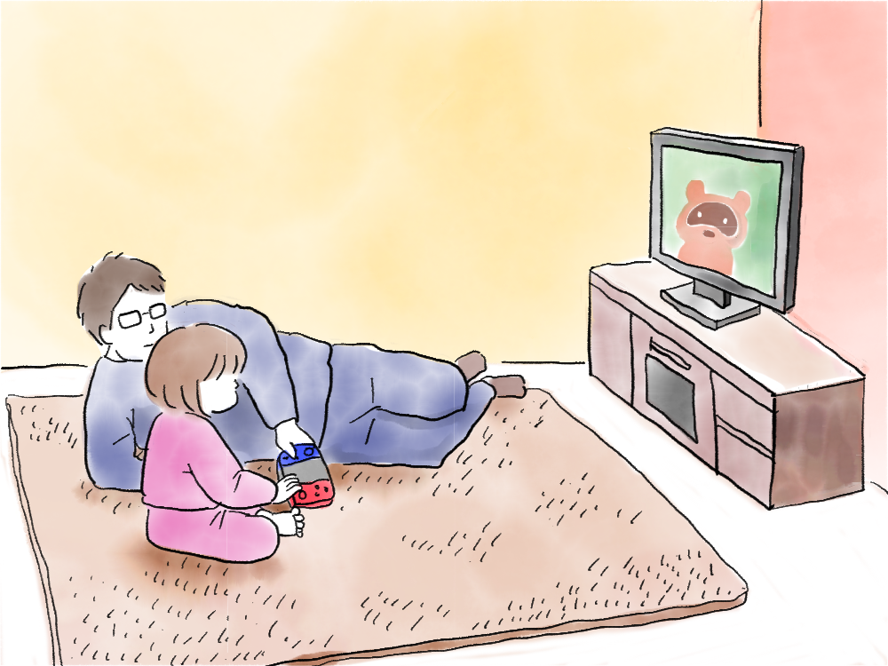 寝転びながらゲームをする父親と娘