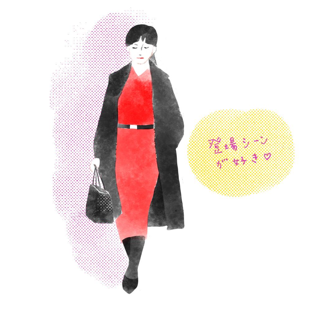 赤いワンピースと黒いコートを着て歩く女性