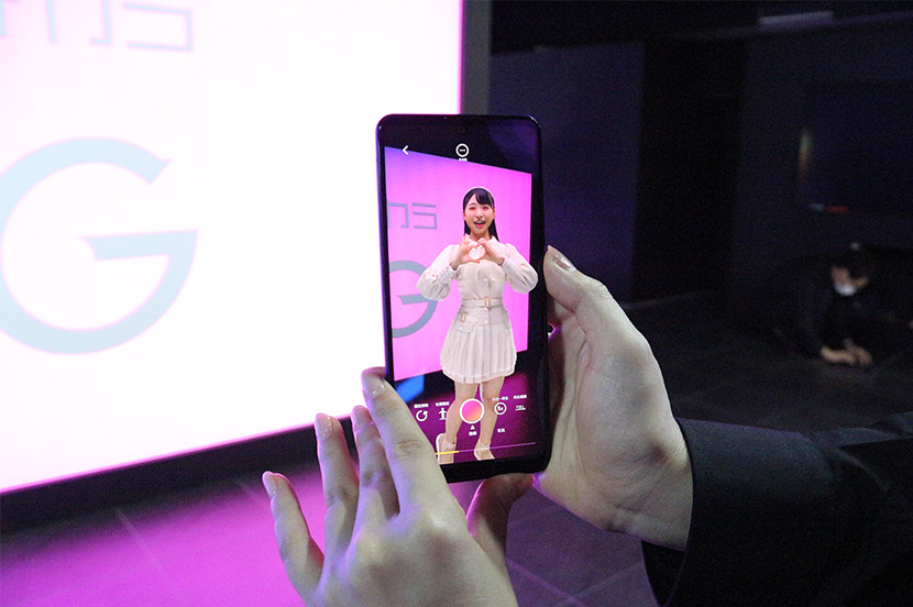 """AR SQUARE"" lets participants dance along with their favorite pop idols and characters, who appear virtually on screen."