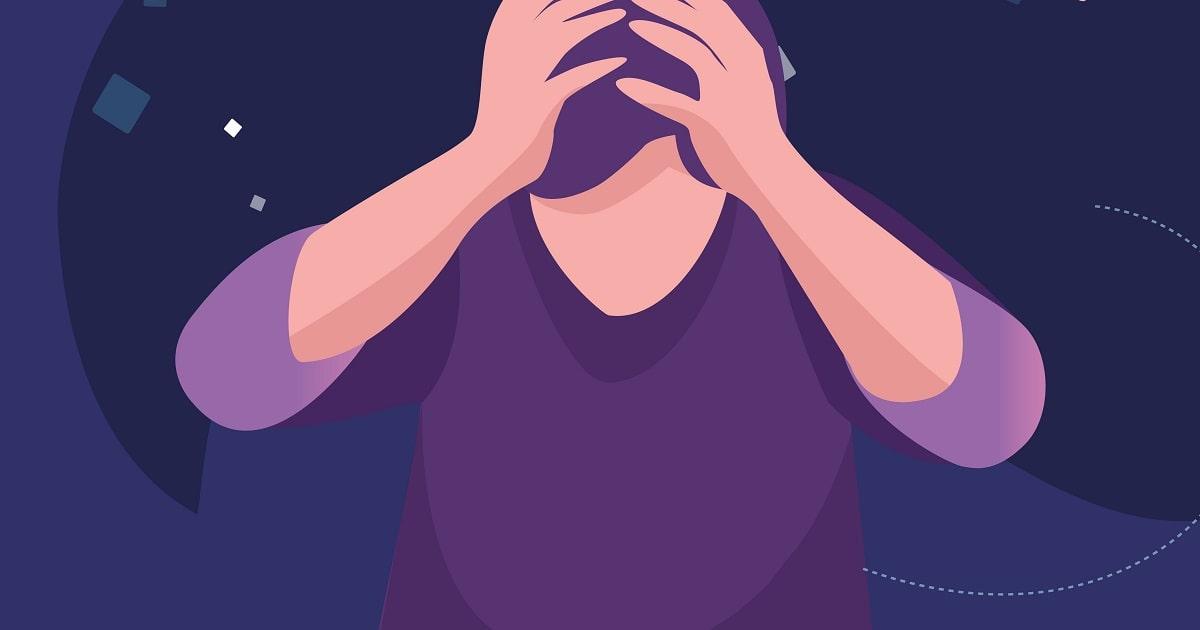 頭を抱え、自己嫌悪に陥る男性のイラスト