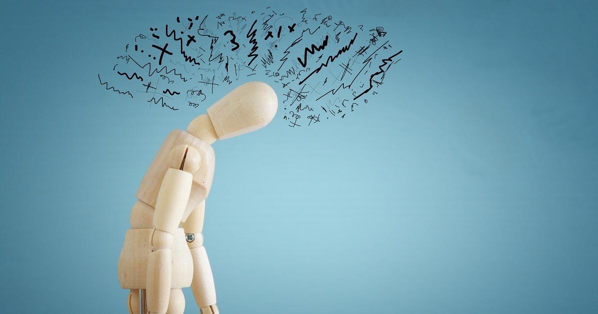 木の人形で表現されたストレスを抱える人のイメージ