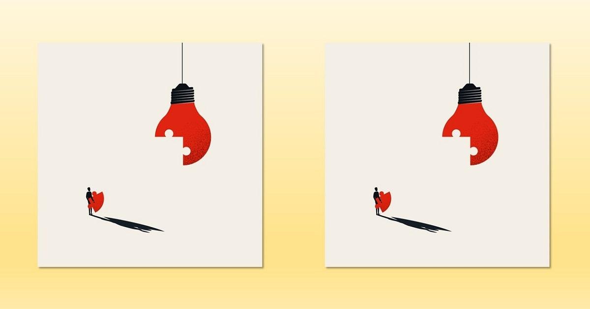 パズルになった赤い電球。インスピレーション、創造的思考のイメージ。