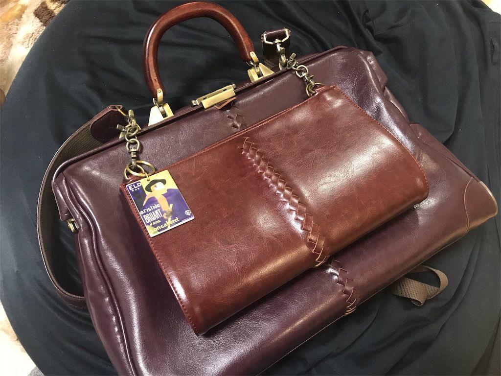 YOUTA(ヨウタ)バッグのダレスリュック横型Lサイズ(バーガンディ色)。木手ロングハンドルとジャケットハンガーをカスタマイズ。