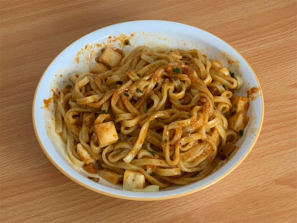汁なし麻辛麺のかき混ぜた写真