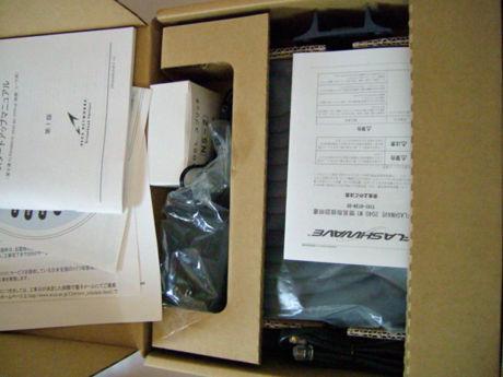 返却のため再梱包したADSLモデムと付属品