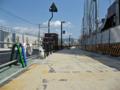[新広島市民球場]北側の道路 駐車場出入口横断歩道から広島貨物ターミナル方面を望む