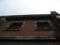 2階の鉄扉を見上げる