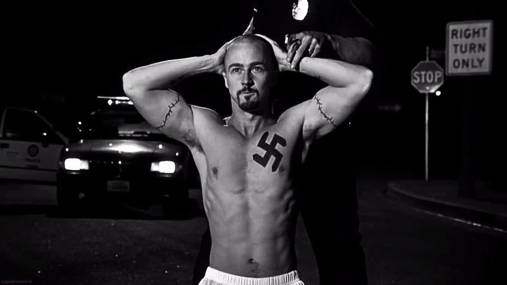 one naked man with nazi tatto is almost captured by police from the scene of american history x