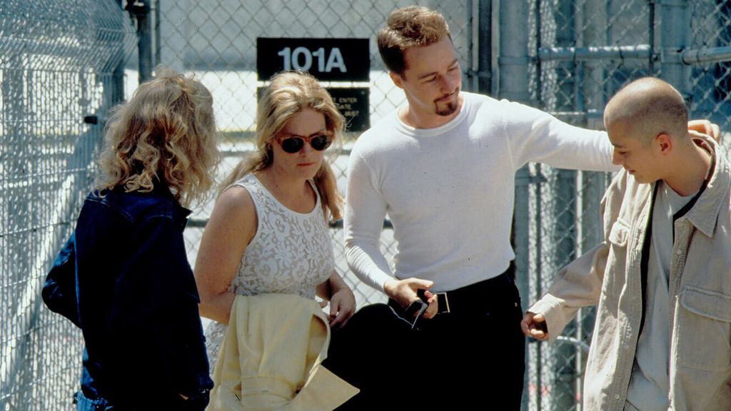 two men and two women is walking behind the jail from the scene of american history x