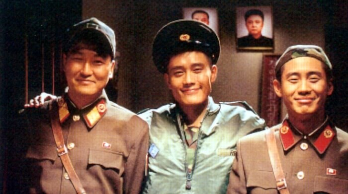 one from south korean and one from north korea are smile