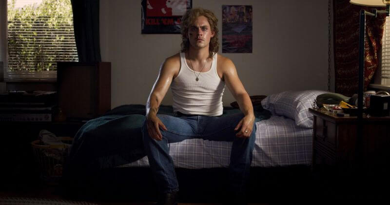 one young guy sitting on the bed
