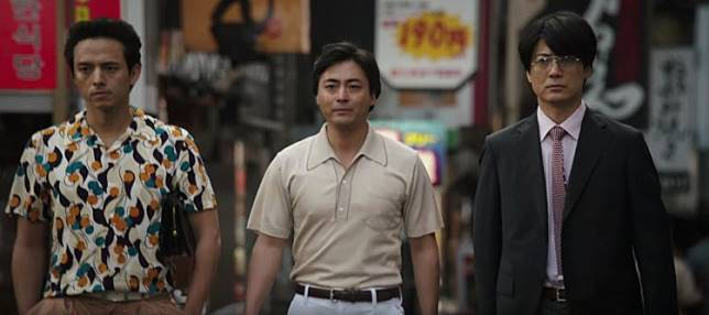 three japanese guys walking and looking at here from the scene of tv show naked director