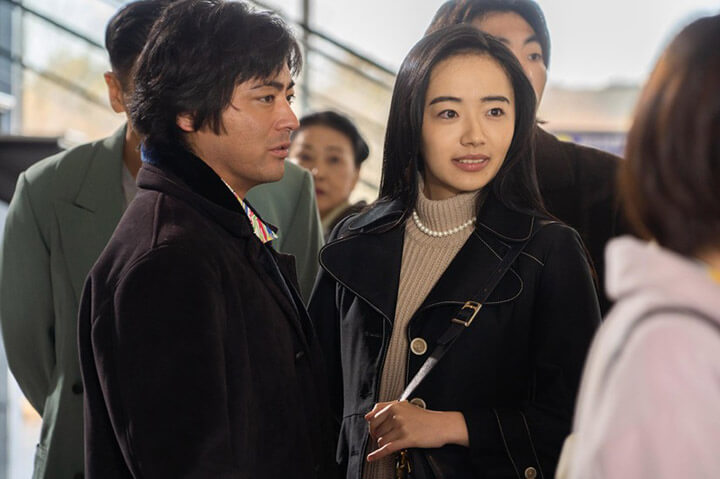 one middle age guy and one beautiful asian female with long hair from the scene of naked director