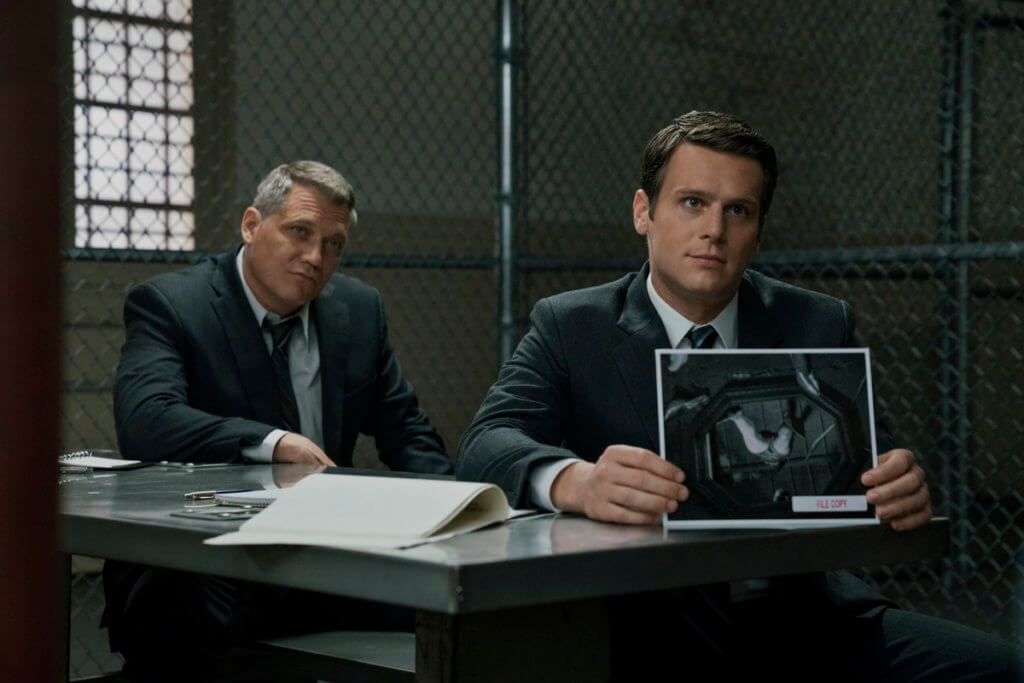two fbi agent seapking with one photo from the scene of mindhunter