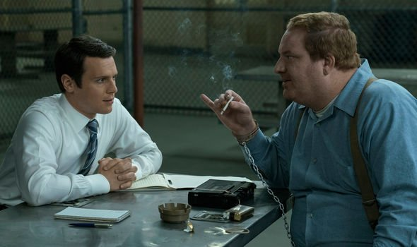 young FBI agent and prisoner with cigarette from the scene mmindhunter