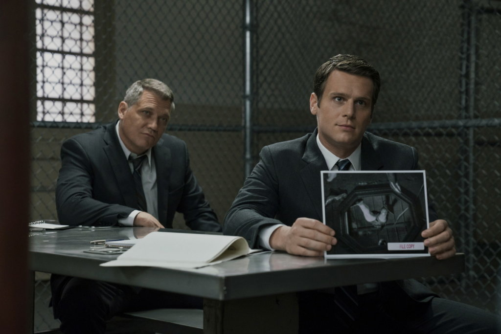 two fbi agent try to make prisoner confess something from the scene of tv show mindhunter