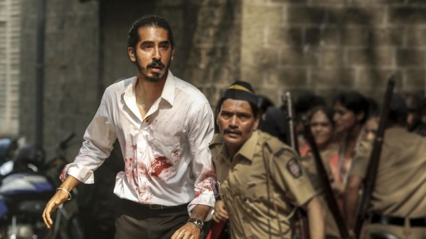 main character with blood looking something from the scene of Hotel Mumbai