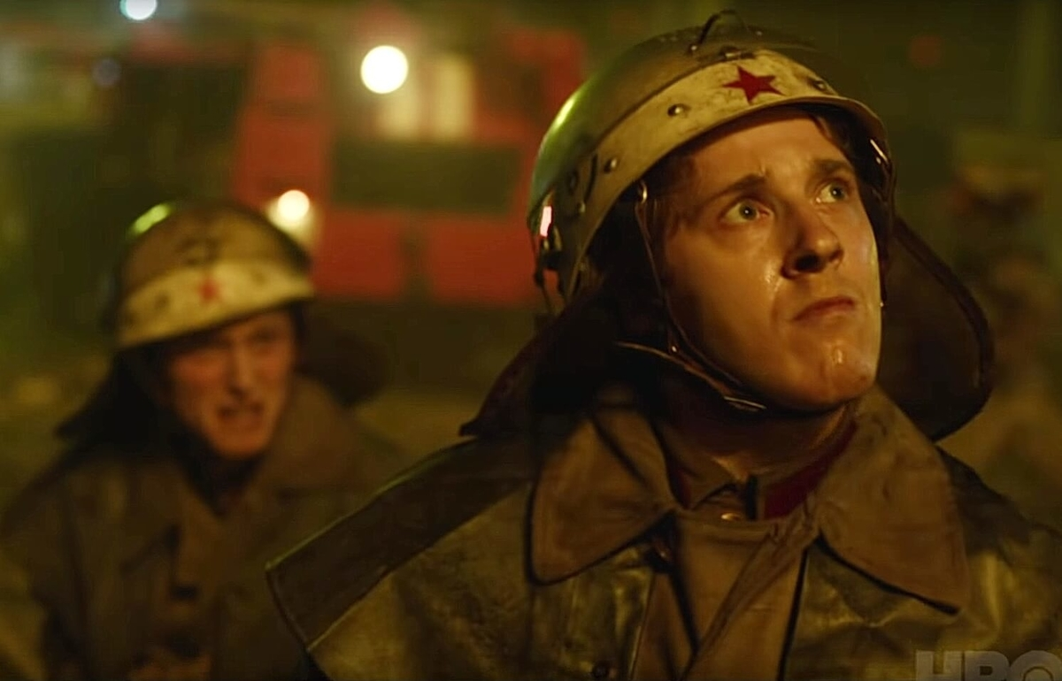 fire fighter looking at above from Tvshow Chernobyl:episode1