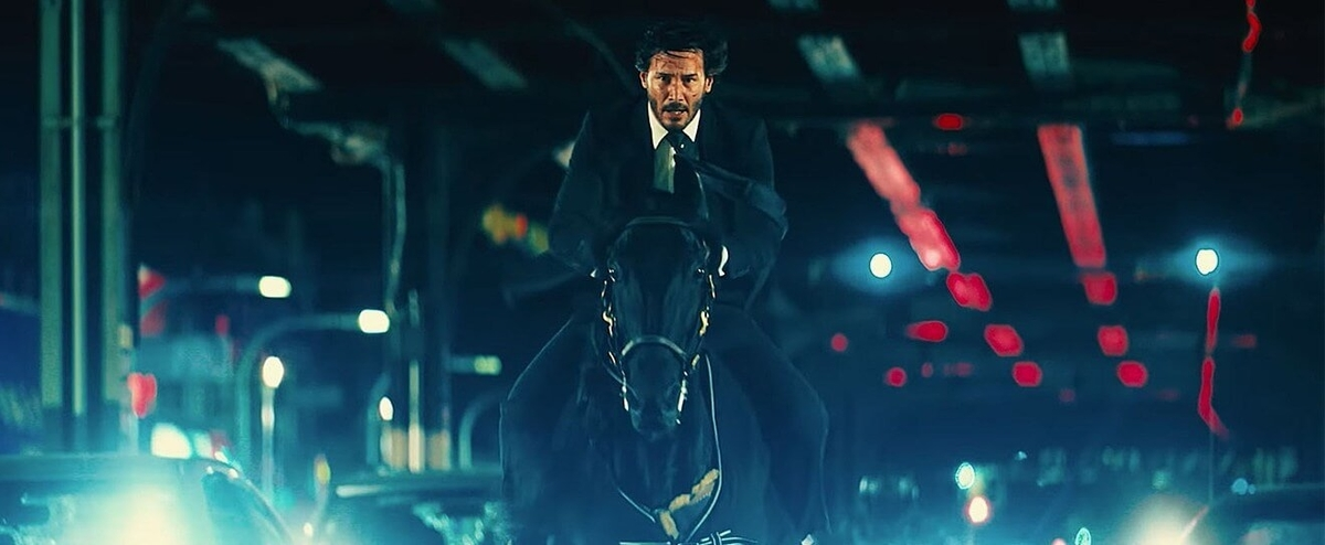 john wick riding hourse from movie John Wick Parabellum