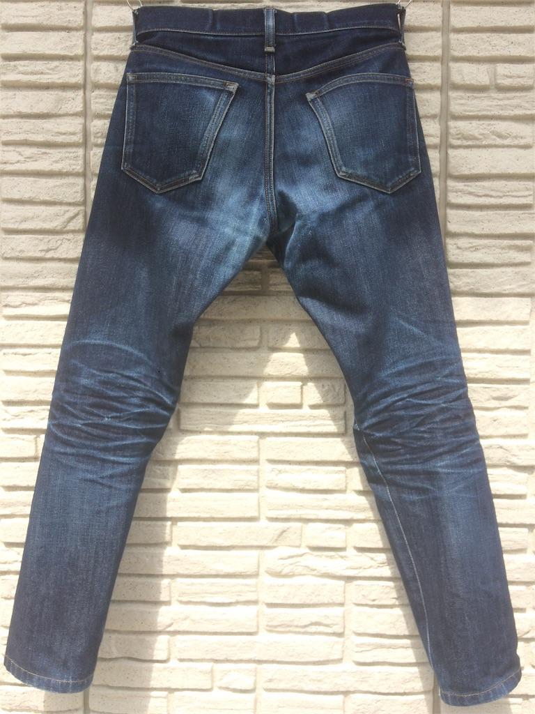 ユニクロセルビッジジーンズ10ヵ月の色落ち洗濯前バック