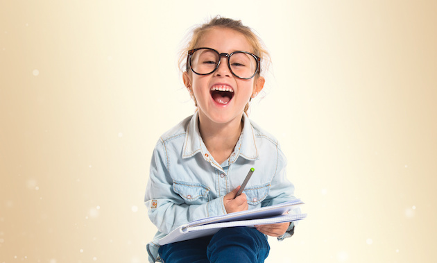Little girl with glasses studing