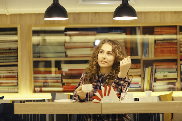 student in a library portrait