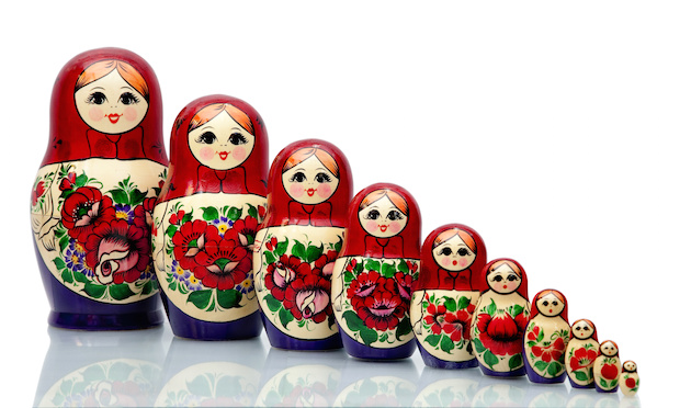 Nested doll - a Old national Russian doll of handwork.