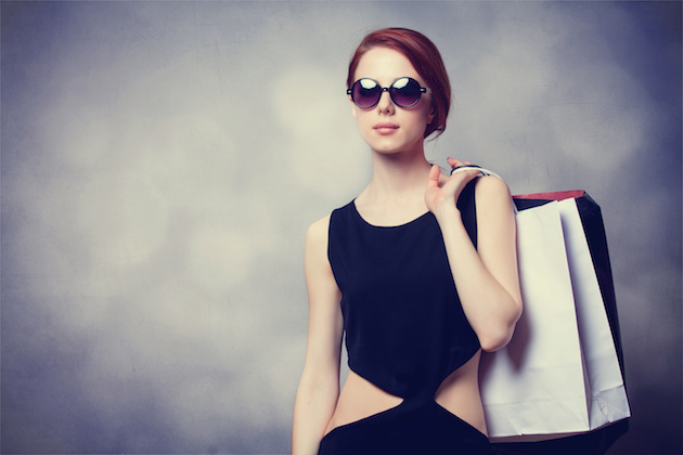 Style redhead girl with shopping bags