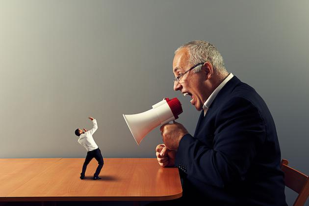 boss screaming at small businessman