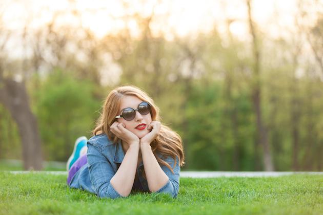 women lying down on green grass