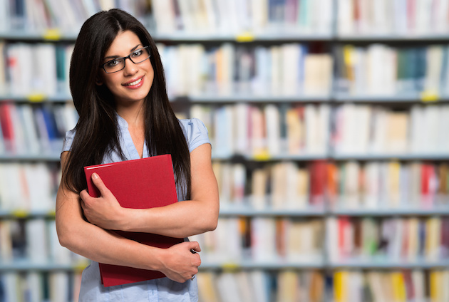 Woman holding a book in a library