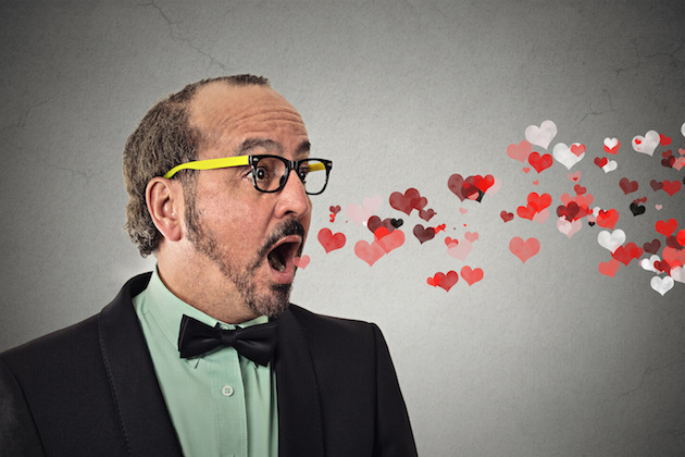 man sending kisses, red hearts coming flying out of open mouth