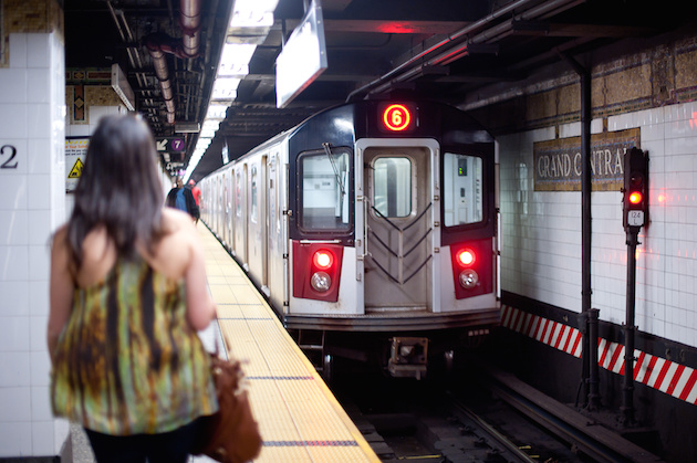 NEW YORK - JUNE 29: Woman waiting on platform on June 29, 2012 in NYC. The NY Subway is one of the oldest and most extensive public transportation systems in the world, with 468 stations.