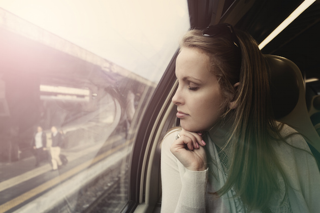 Pensive beautiful woman in a train