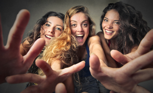 Happy girls making jokes