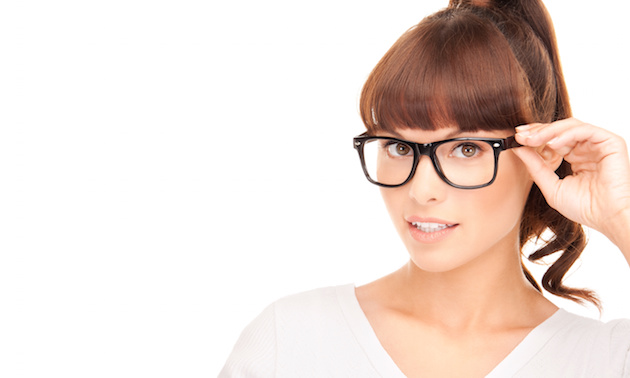 asian woman adjusting eyeglasses