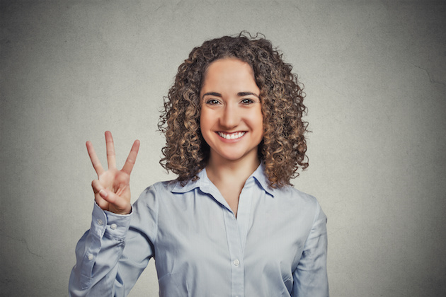 woman showing three fingers sign gesture