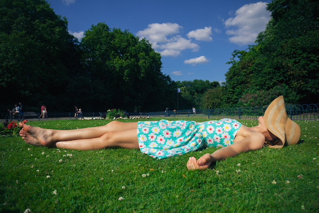 Young woman with hat relaxing in park