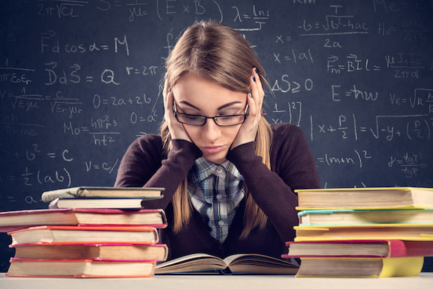 Student with desperate expression looking at her books