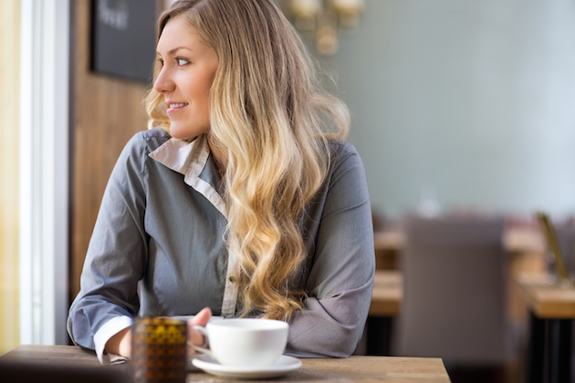 Woman With Coffee Cup At Coffeeshop