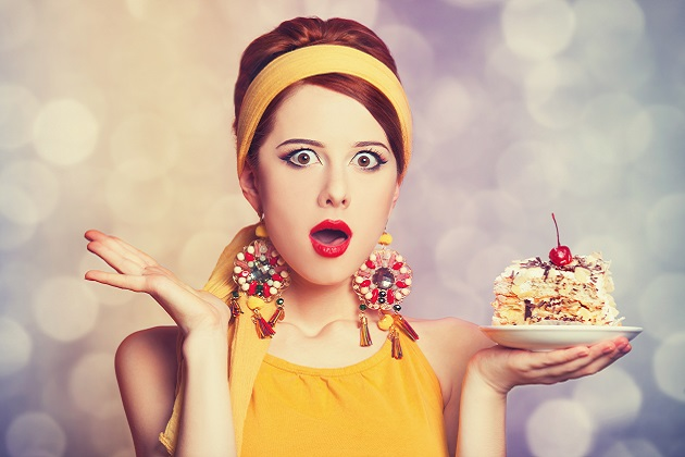 Style redhead girl with cake.