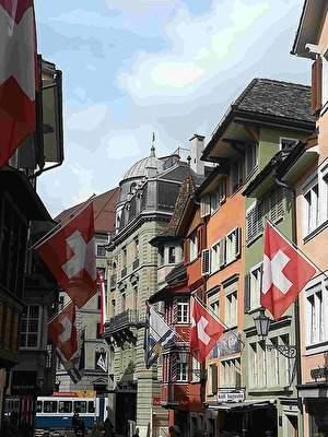 スイスの通り。歴史的な建物にスイスの旗がいくつも飾られている。
