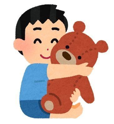 男の子がくまのぬいぐるみを抱きしめているイラスト。