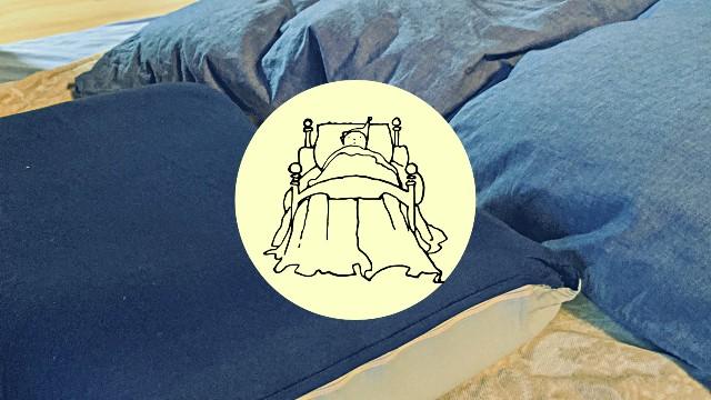 体調が悪くて寝ている妻の画像
