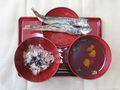 お食い初め:赤飯、尾頭付きの焼魚(子持ちししゃも)、すまし汁