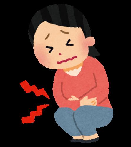 IBSガス型でお腹を抱えている女性