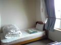 片付け後のなよろサンピラーユースホステルの部屋