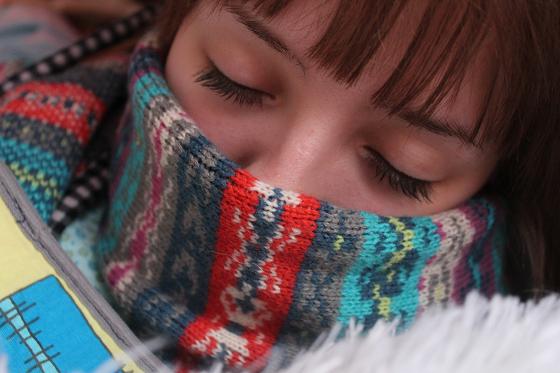 風邪かインフルエンザに罹患した女性