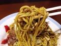 [秋田][横手][焼きそば][居酒屋]絡まる黄身で存在感を高めた太い麺をズビビビビン!