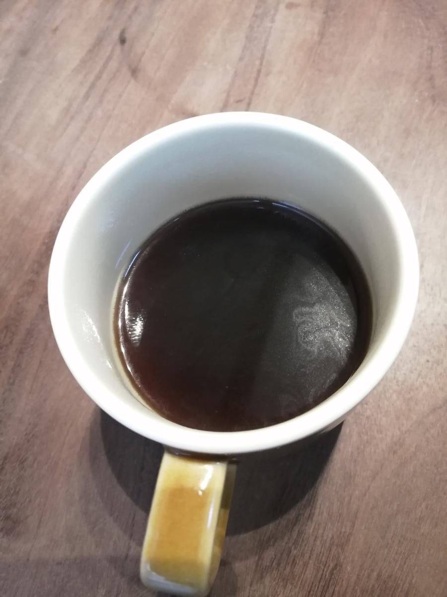 コーヒーの入ったコップの写真
